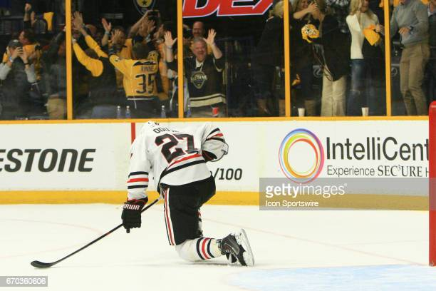 Nashville Predators fans celebrate as Chicago Blackhawks defenseman Johnny Oduya reacts to the gamewinning goal by Nashville Predators left wing...