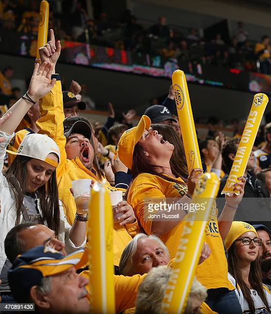 Nashville Predators fans cheer after a goal against the Chicago Blackhawks in Game Five of the Western Conference Quarterfinals during the 2015 NHL...