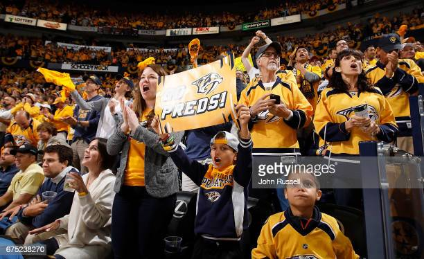 Nashville Predators fans cheer on their team late in the third period against the St Louis Blues in Game Three of the Western Conference Second Round...