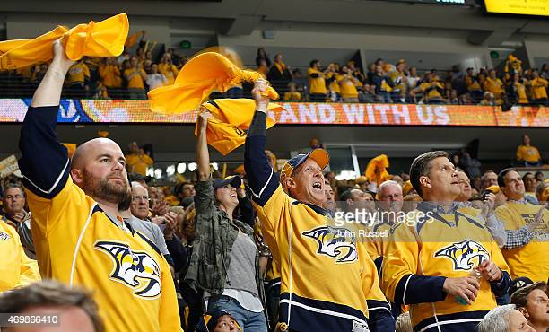 Nashville Predators fans give a standing ovation during a break in play against the Chicago Blackhawks in Game One of the Western Conference...