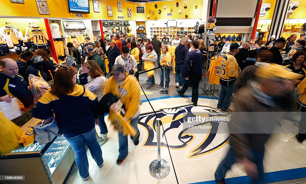 Nashville Predators fans visit the Pro Shop before the puck drops against the St. Louis Blues during an NHL game at the Bridgestone Arena on January 21, 2013 in Nashville, Tennessee.