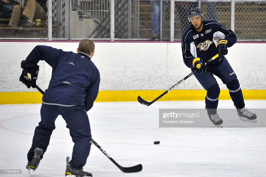 Nashville Predators first round draft pick Seth Jones #3 skates with a coach at the 2013 Nashville Predators Development Camp at the Centennial Sportsplex on July 10, 2013 in Nashville, Tennessee.
