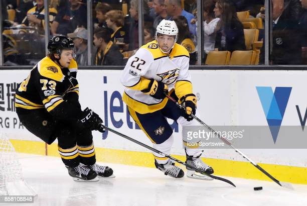 Nashville Predators forward Kevin Fiala looks for help as Boston Bruins right defenseman Charlie McAvoy moves in during an NHL game between the...