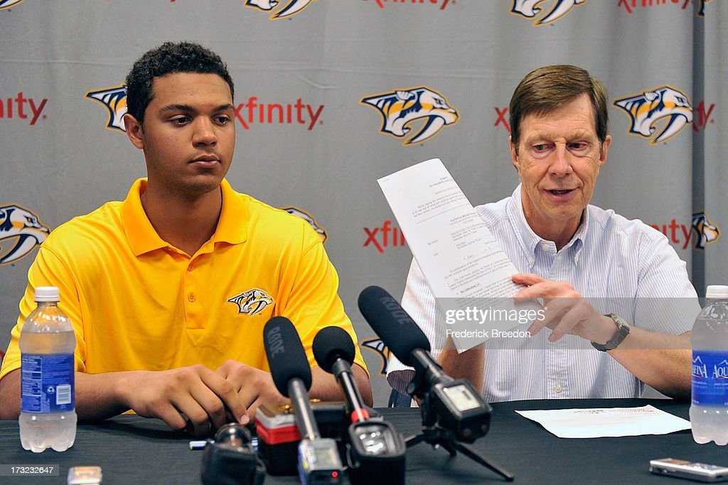 Nashville Predators General Manager David Poille holds up a three-year entry-level contract with the Nashville Predators for prospect Seth Jones at the 2013 Nashville Predators Development Camp at the Centennial Sportsplex on July 10, 2013 in Nashville, Tennessee.
