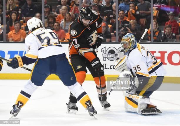 Nashville Predators Goalie Pekka Rinne and Anaheim Ducks Center Ryan Kesler look for the deflected puck during game 5 of the 2017 NHL Western...