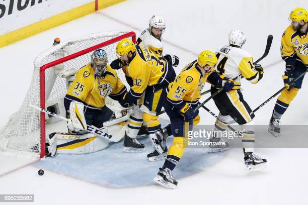 Nashville Predators goalie Pekka Rinne and Nashville Predators center Frederick Gaudreau track loose puck during game 6 of the 2017 NHL Stanley Cup...
