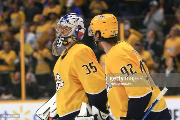 Nashville Predators goalie Pekka Rinne and Nashville Predators center Ryan Johansen talk during the NHL game between the Nashville Predators and the...