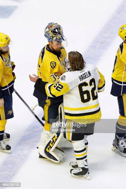 Nashville Predators goalie Pekka Rinne and Pittsburgh Penguins left wing Carl Hagelin shake hands after game 6 of the 2017 NHL Stanley Cup Finals...