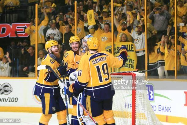 Nashville Predators goalie Pekka Rinne celebrates with center Calle Jarnkrok defenseman Roman Josi and defenseman Ryan Ellis at the conclusion of...
