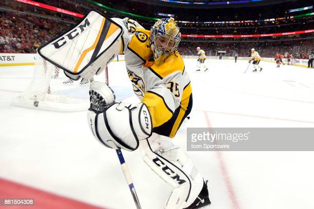 Nashville Predators goalie Pekka Rinne clears the puck during a game between the Chicago Blackhawks and the Nashville Predators on October 14 at the...