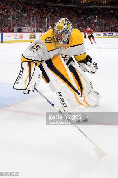 Nashville Predators goalie Pekka Rinne controls the puck during a game between the Chicago Blackhawks and the Nashville Predators on October 14 at...