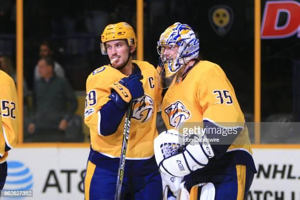 Nashville Predators goalie Pekka Rinne is congratulated by Nashville Predators defenseman Roman Josi following the NHL game between the Nashville...