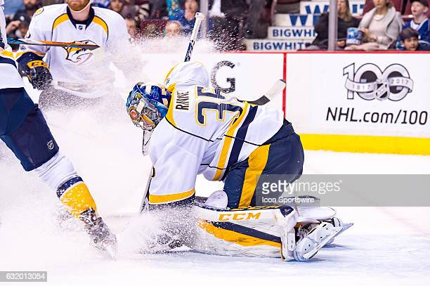Nashville Predators Goalie Pekka Rinne is sprayed by snow as he makes a save against the Vancouver Canucks during their NHL game at Rogers Arena on...