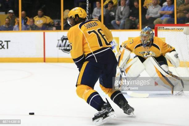 Nashville Predators goalie Pekka Rinne looks on as Nashville Predators defenseman PK Subban clears the puck during the NHL game between the Nashville...