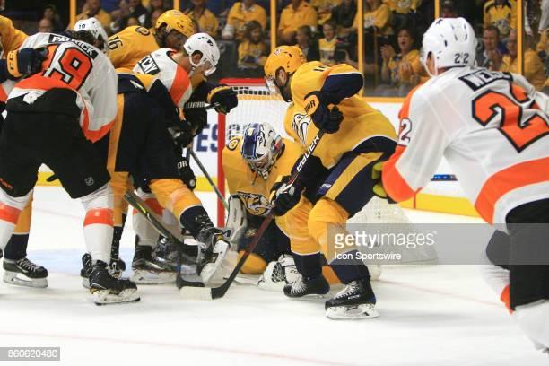 Nashville Predators goalie Pekka Rinne makes a save during the NHL game between the Nashville Predators and the Philadelphia Flyers held on October...