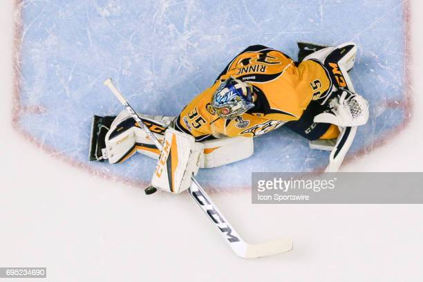 Nashville Predators goalie Pekka Rinne makes save during warmups prior to game 6 of the 2017 NHL Stanley Cup Finals between the Pittsburgh Penguins...