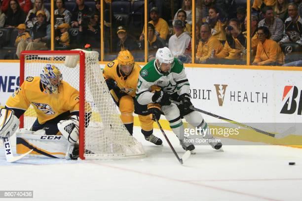 Nashville Predators goalie Pekka Rinne protects the post as Nashville Predators center Calle Jarnkrok defends against Dallas Stars winger Devin Shore...