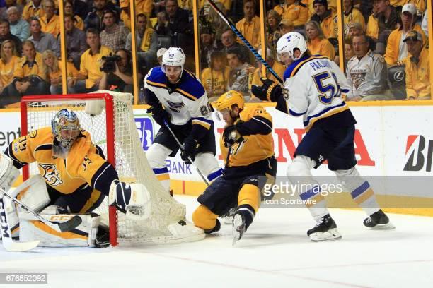 Nashville Predators goalie Pekka Rinne protects the post as St Louis Blues left wing Magnus Paajarvi St Louis Blues left wing Zach Sanford and...