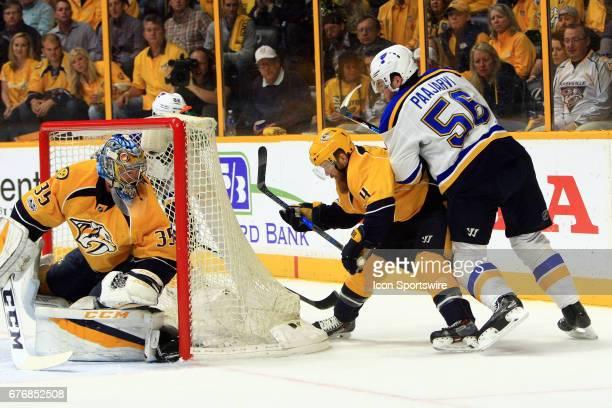 Nashville Predators goalie Pekka Rinne protects the post as St Louis Blues left wing Magnus Paajarvi and Nashville Predators defenseman Ryan Ellis...