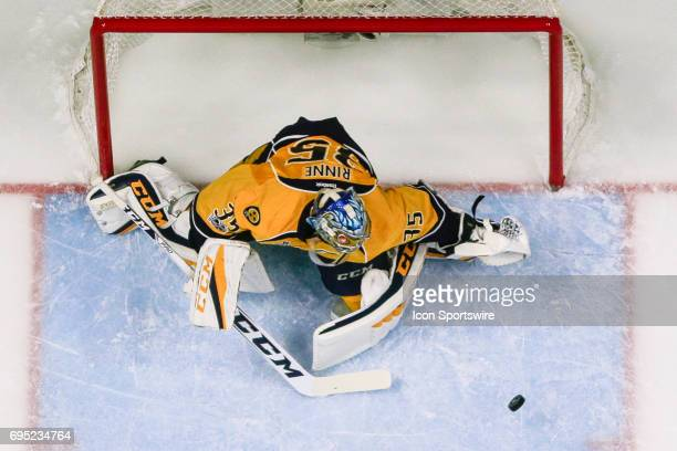 Nashville Predators goalie Pekka Rinne tracks loose puck in the crease during game 6 of the 2017 NHL Stanley Cup Finals between the Pittsburgh...