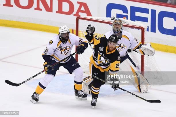 Nashville Predators goalie Pekka Rinne watches an airborne puck as Pittsburgh Penguins center Scott Wilson and Nashville Predators defenseman PK...