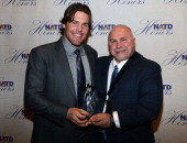 Nashville Predators Head Coach Barry Trotz presents NHL Nashville Predators player Mike Fisher with his NATD Award during the 2012 NATD Honors at The...