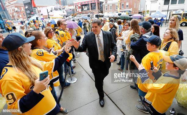 Nashville Predators head coach Peter Laviolette greets fans prior to an NHL game against the Philadelphia Flyers at Bridgestone Arena on October 10...