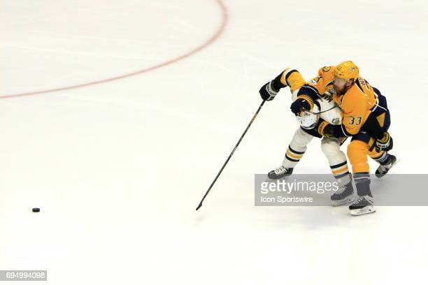 Nashville Predators left wing Colin Wilson and Pittsburgh Penguins defenseman Olli Maatta battle for the loose puck during Game 6 of the Stanley Cup...