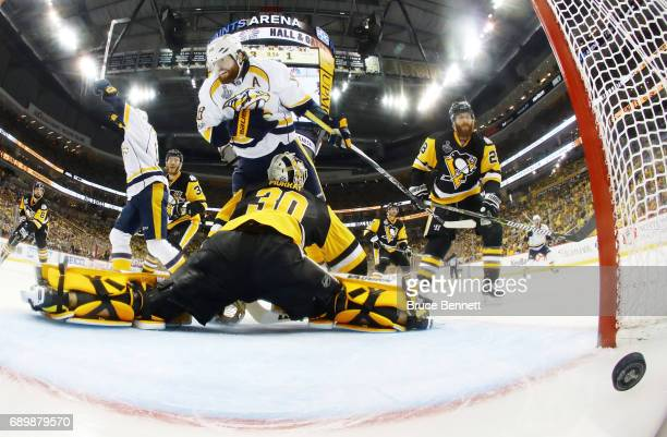 Nashville Predators left wing James Neal collides with Pittsburgh Penguins goalie Matt Murray as center Colton Sissons scores at 1013 of the third...
