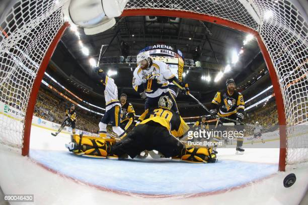 Nashville Predators left wing James Neal trips over Pittsburgh Penguins goalie Matt Murray during a goal by center Colton Sissons during Game One of...