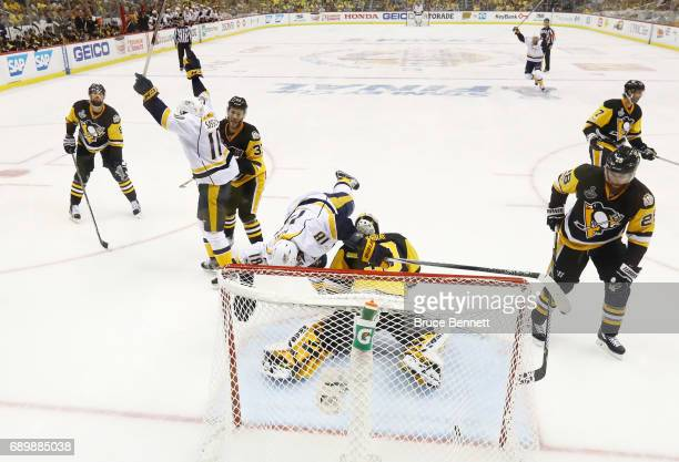Nashville Predators left wing James Neal tumbles over Pittsburgh Penguins goalie Matt Murray in Game One of the 2017 NHL Stanley Cup Final at PPG...