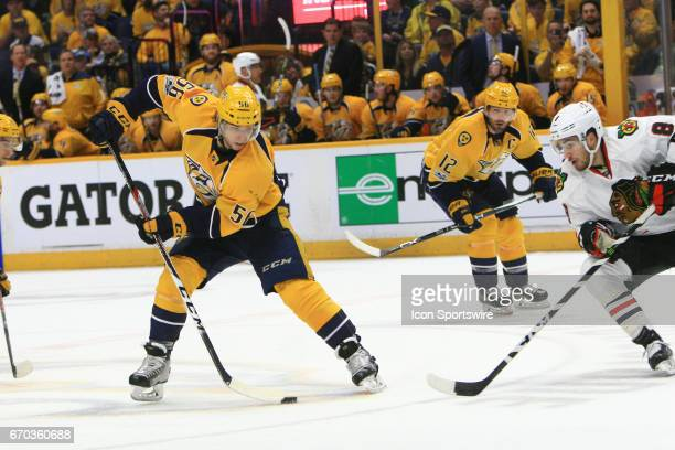 Nashville Predators left wing Kevin Fiala drops the pass between his legs as Chicago Blackhawks winger Nick Schmaltz defends during game three of...