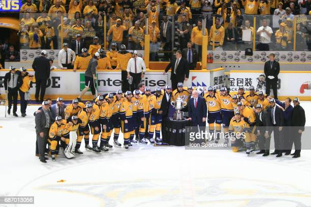 Nashville Predators left wing Kevin Fiala left and Nashville Predators center Ryan Johansen use crutches to join their teammates for the team picture...