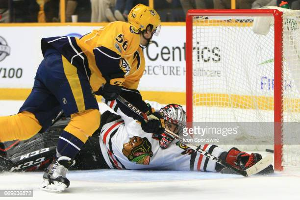 Nashville Predators left wing Kevin Fiala scores on Chicago Blackhawks goalie Corey Crawford during the first overtime during game three of the...