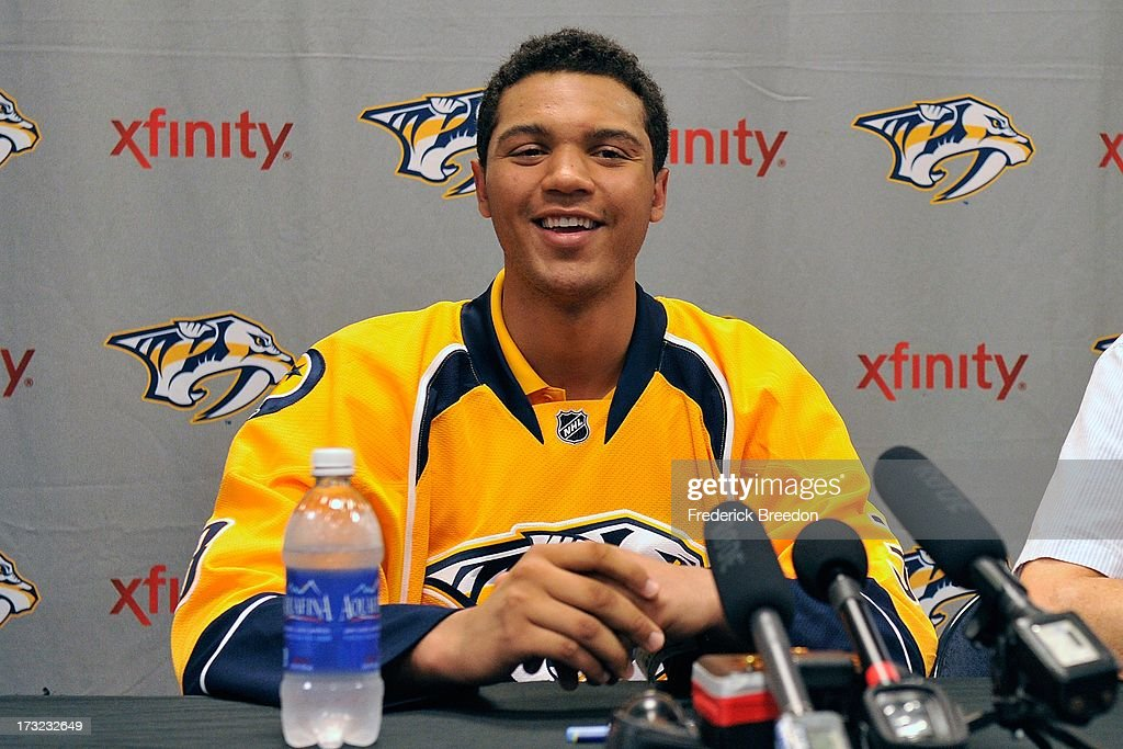 Nashville Predators prospect Seth Jones #3 addresses the media after signing a three-year entry-level deal with the Nashville Predators at the 2013 Nashville Predators Development Camp at the Centennial Sportsplex on July 10, 2013 in Nashville, Tennessee.