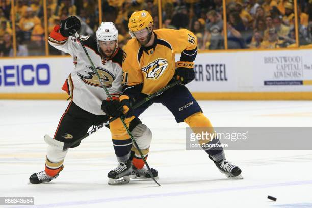Nashville Predators right wing Austin Watson and Anaheim Ducks left wing Nic Kerdiles battle for position following a face off during Game 6 of the...