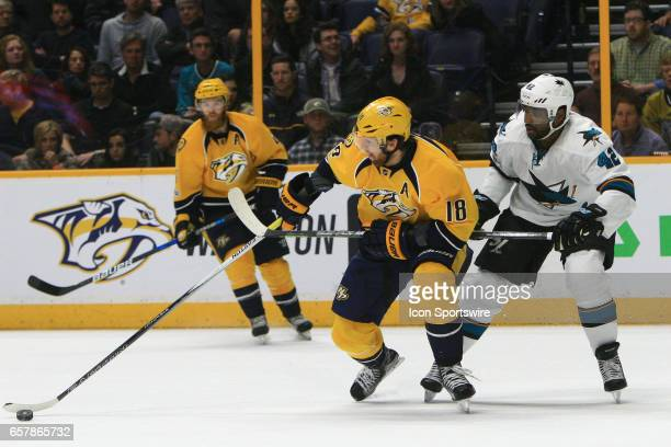 Nashville Predators right wing James Neal shields the puck from San Jose Sharks right wing Joel Ward during the NHL game between the Nashville...