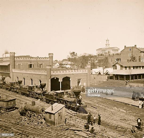 Nashville Tenn Railroad yard and depot with locomotives the Capitol in distance