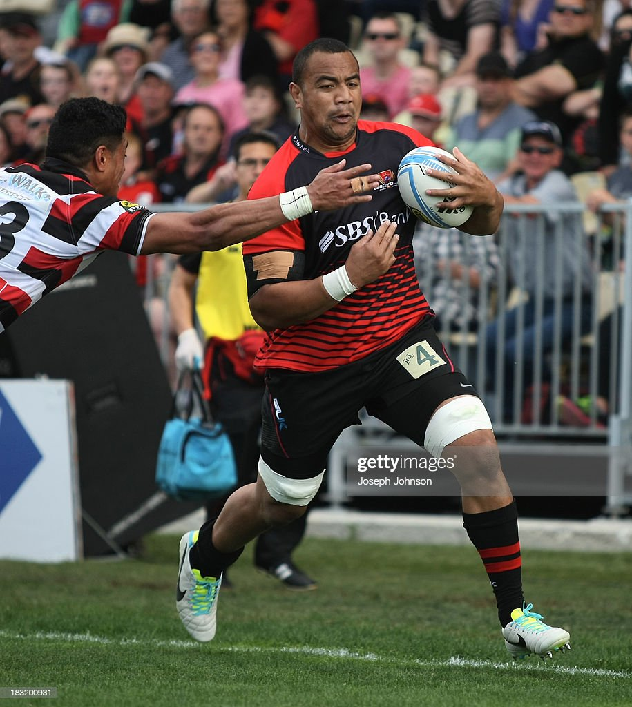 Nasi Manu of Canterbury in the lead up to scoreing a try in defence is Sam Vaka of Counties Manukau during the round eight ITM Cup match between Cantebury and Counties Manukau at AMI Stadium on October 6, 2013 in Christchurch, New Zealand.