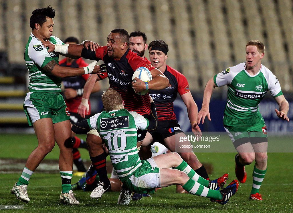 Nasi Manu of Canterbury is tackled by Nico Malo and Nate George of Manawatu during the round 7 ITM Cup match between Canterbury and Manawatu at AMI Stadium on September 25, 2013 in Christchurch, New Zealand.