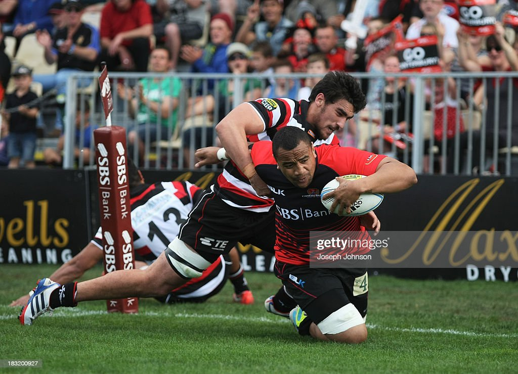 Nasi Manu of Canterbury scores a try in the tackle of Johnny Kawau of Counties Manukau during the round eight ITM Cup match between Cantebury and Counties Manukau at AMI Stadium on October 6, 2013 in Christchurch, New Zealand.