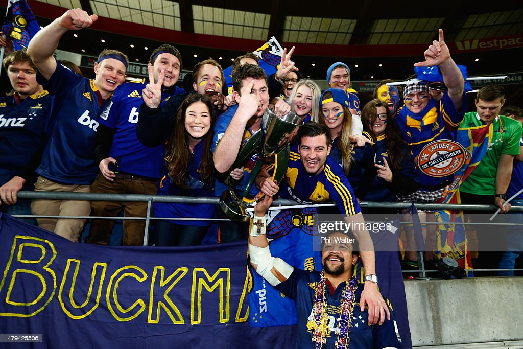Nasi Manu of the Highlanders holds the trophy up for fans following the Super Rugby Final match between the Hurricanes and the Highlanders at Westpac Stadium on July 4, 2015 in Wellington, New Zealand.