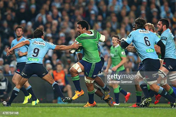 Nasi Manu of the Highlanders runs the ball during the Super Rugby Semi Final match between the Waratahs and the Highlanders at Allianz Stadium on...