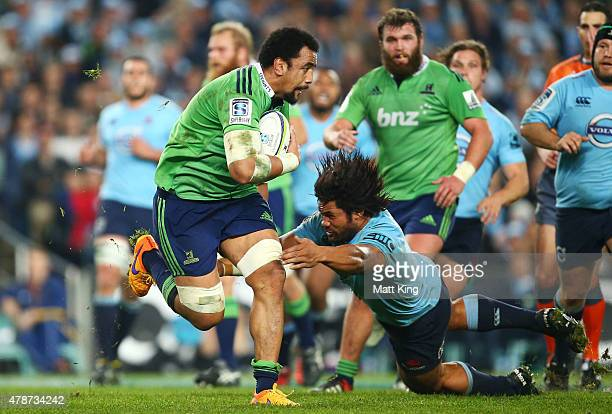 Nasi Manu of the Highlanders runs with the ball during the Super Rugby Semi Final match between the Waratahs and the Highlanders at Allianz Stadium...