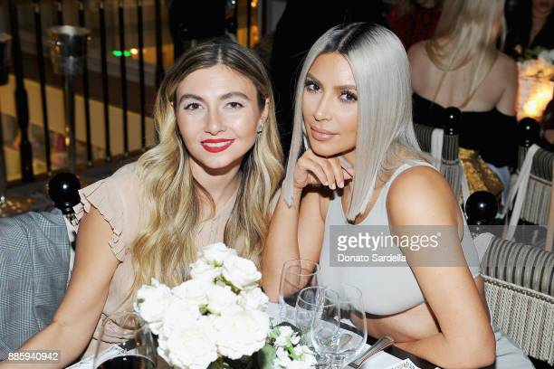 Nasiba Adilova and Kim Kardashian West attend The Tot holiday popup celebration at Laduree at the Grove on December 4 2017 in Los Angeles California
