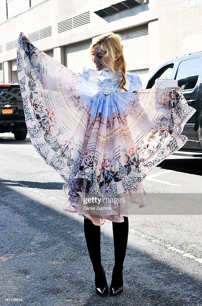 Nasiba Adilova seen outside the Ralph Lauren show wearing a Maekajando dress on February 14, 2013 in New York City.