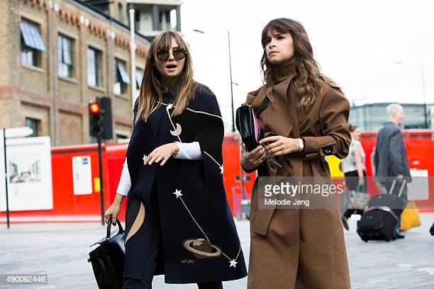 Nasiba Adilova wears a blue Valentino cape with planets and stars while Miroslava Duma wears a brown AWAKE trench coat and Hermes purse during London...