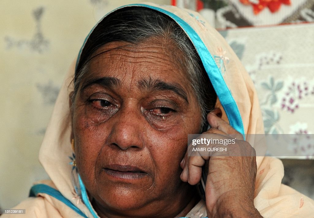 Nasim Akhtar, mother of former Pakistani cricketer Mohammad Aamer weeps as she speaks on a cellular phone after the London's court verdict against her son ... - nasim-akhtar-mother-of-former-pakistani-cricketer-mohammad-aamer-as-picture-id131239181