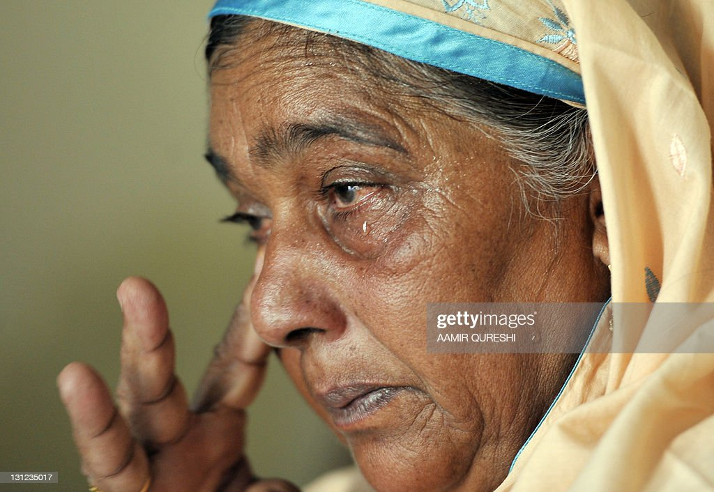 Nasim Akhtar, mother of former Pakistani cricketer Mohammad Aamer, reacts after the London's court verdict against her son Aamer at her residence in Changa ... - nasim-akhtar-mother-of-former-pakistani-cricketer-mohammad-aamer-picture-id131235017