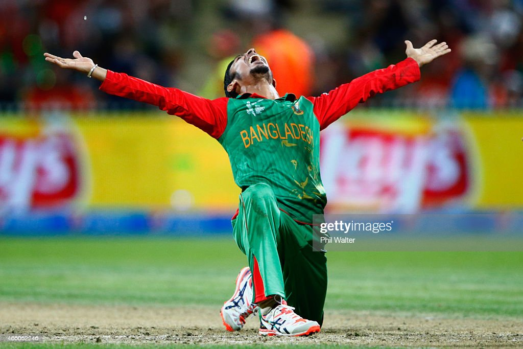 <a gi-track='captionPersonalityLinkClicked' href=/galleries/search?phrase=Nasir+Hossain&family=editorial&specificpeople=4879926 ng-click='$event.stopPropagation()'>Nasir Hossain</a> of Bangladesh celebrates his wicket of Ross Taylor of New Zealand during the 2015 ICC Cricket World Cup match between Bangladesh and New Zealand at Seddon Park on March 13, 2015 in Hamilton, New Zealand.